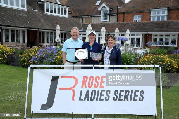 Gemma Dryburgh of Scotland holds the winner's rosebowl with her parents John Dryburgh and her mother Marjorie Dryburgh after her win in The Rose...