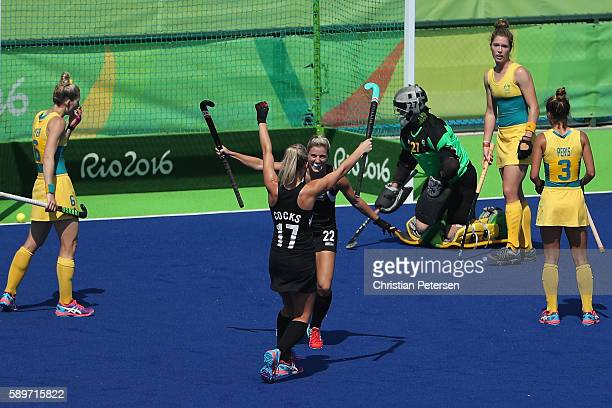 Gemma Flynn and Sophie Cocks of New Zealand celebrate after Flynn scored a goal past goalkeeper Rachael Lynch of Australia during the quarter final...