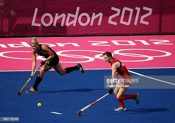 Gemma Flynn of New Zealand passes the ball against Helen Richardson of Great Britain during the Women's Hockey bronze medal match on Day 14 of the...