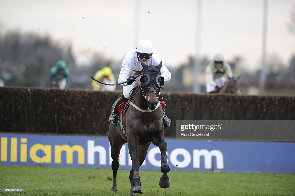 Gemma Gracey-Davidson riding Nozic clear the last to win The Racing Plus Chase Day 23.02.13 Handicap Steeple Chase at Kempton racecourse on February 08, 2013 in Sunbury, England.