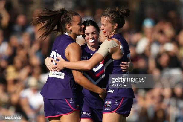 Gemma Houghton, Sabreena Duffy and Ebony Antonio of the Dockers celebrate a goal during the round five AFLW match between the Fremantle Dockers and...