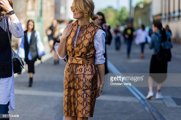 Gemma Keil wearing a beige snakeskin leather dress outside Georgia Alice at MercedesBenz Fashion Week Resort 17 Collections at Carriageworks on May...