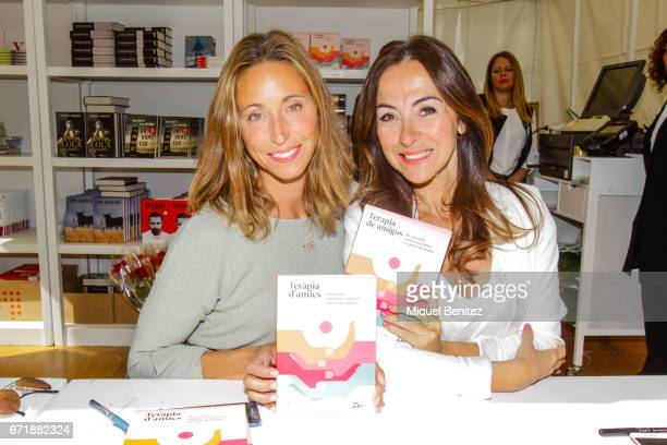 Gemma Mengual and Carme Barcelo singning books during 'Sant Jordi's Day' 'Saint George's Day' at Plaa Catalunya on April 23 2017 in Barcelona Spain