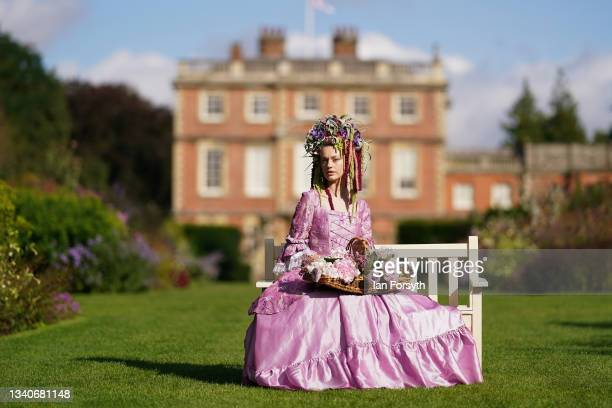 Gemma Sadler wears a Georgian costume, including a wig made from flowers and foliage during a photo call on staging day for Harrogate Autumn flower...