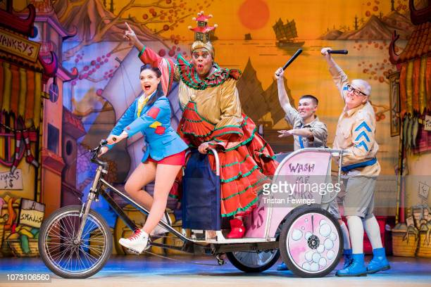 Gemma Sutton as Aladdin Clive Rowe as Widow Twankey Michael Lin as Constable Ackee and Tony Whittle as Sergeant Dumpling pose during a photocall for...