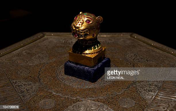 A gemset gold finial from the throne of Tipu Sultan the Tiger of Mysore is displayed at Bonham's auction house in central London on October 4 2010...