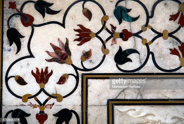 'Gemstones inlay by Mughal craftsmen 16321653 17th Century gemstone inlay on marble India Agra Taj Mahal Detail A decorative phytomorphic pattern...
