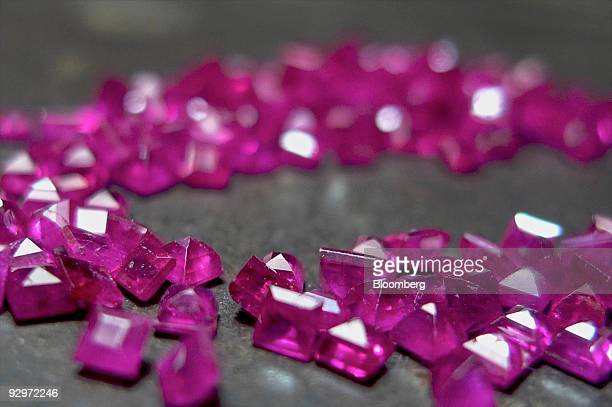 Gemstones known as a ruby diamonds are kept on a work table at a diamond finishing and jewelry workshop in Mumbai India on Tuesday Nov 10 2009 Rough...