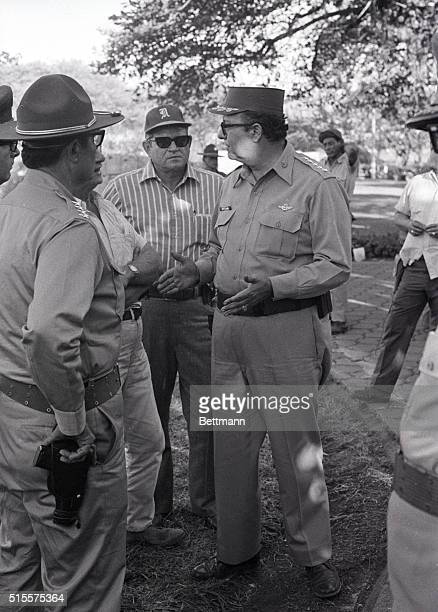 Gen Anastasio Somoza talks to aides after issuing orders to troops to 'shoot to kill' in enforcing a dawntodusk curfew in this earthquake shattered...