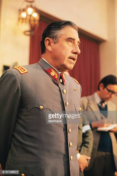 Gen. Augusto Pinochet, head of Chile's ruling military junta, holds a news conference at Santiago's War College September 21. He said that neither...