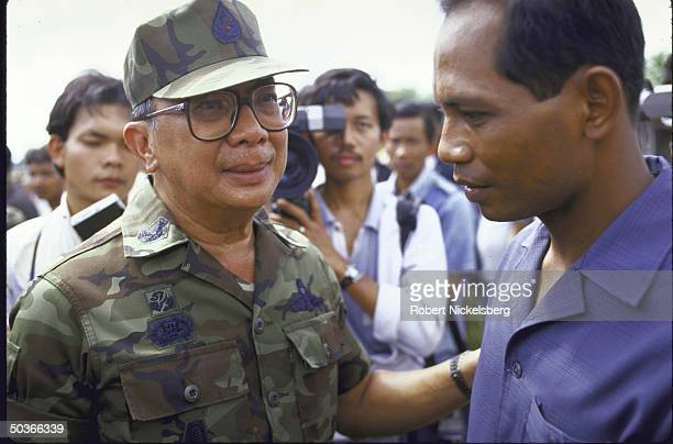 Gen. Chavalit Yongchaiyudh attending mass cremation ceremony for previously killed communist fighters.