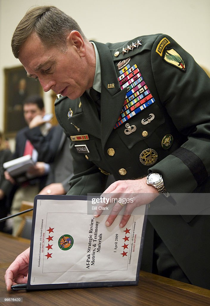 Gen. David Petraeus, commander of the U.S. Central Command, gathers his papers during a break in the House Armed Services Committee hearing on the new strategy for Afghanistan and Pakistan on Thursday, April 2, 2009.
