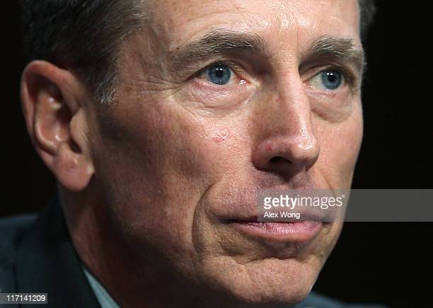 Gen David Petraeus listens during his confirmation hearing before the Senate Intelligence Committee June 23 2011 on Capitol Hill in Washington DC Gen...