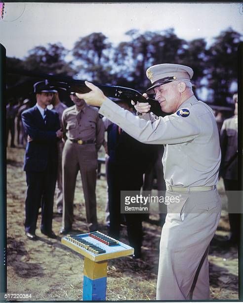 Gen. Henry H. Arnold, commanding general, U.S. Army Air Forces, shown with shotgun of the type used in training aerial gunners.