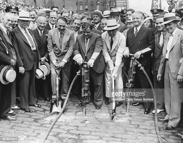 Gen Hugh Johnson Mayor Fiorello LaGuardia Parks Commissioner Robert Moses and Samuel Levy wield tools in ground breaking ceremony for the new East...