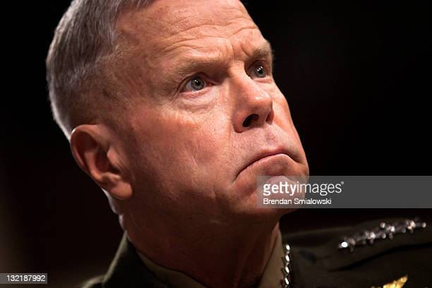 Gen James Amos commandant of the Marine Corps listens during a hearing of the Senate Armed Services Hearing on Capitol Hill November 10 2011 in...
