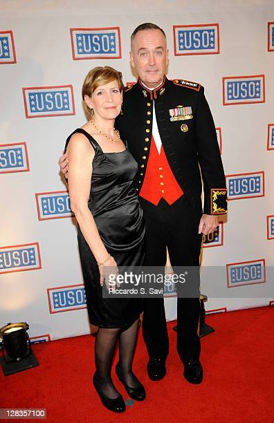 Gen Joseph Dunford Jr and his wife arrive at the 2011 USO Gala and USO Service Member of the Year Awards at the Marriott Wardman Park Hotel on...