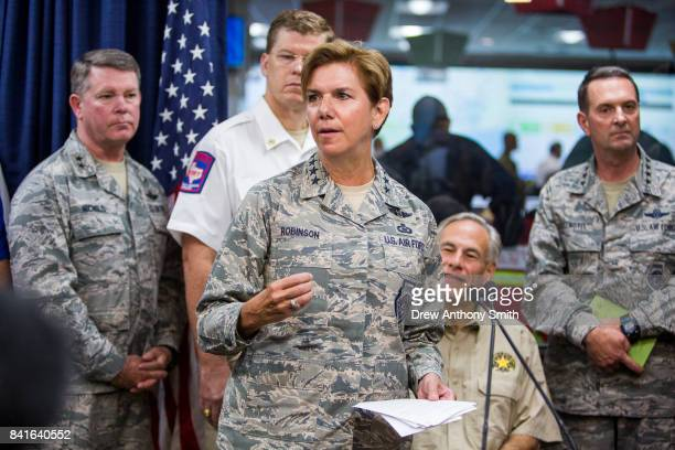 Gen Lori J Robinson delivers a briefing to the public alongside Gov Greg Abbott on Hurricane Harvey at the Texas Department of Public Safety building...