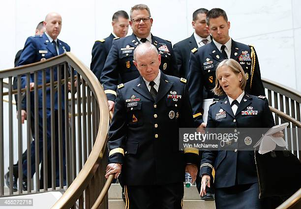 Gen Martin Dempsey chairman of the Joint Chiefs of Staff and military officials arrive to brief members of the US Senate on the White House strategy...
