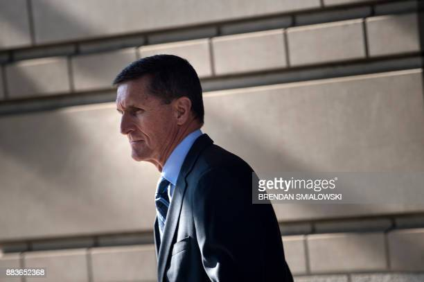 Gen Michael Flynn former national security adviser to US President Donald Trump leaves Federal Court December 1 2017 in Washington DC Donald Trump's...