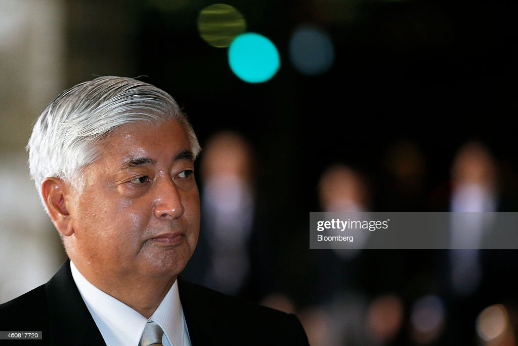 Gen Nakatani, Japan's newly appointed defense minister, arrives at the prime minister's official residence before heading to the Imperial Palace for the attestation ceremony in Tokyo, Japan, on Wednesday, Dec. 24, 2014. Japanese Prime Minister Shinzo Abe appointed Nakatani, a former soldier and security veteran as his new defense minister, as he prepares to push through legislation to toughen the country's military stance amid a dispute with China. Photographer: Kiyoshi Ota/Bloomberg via Getty Images