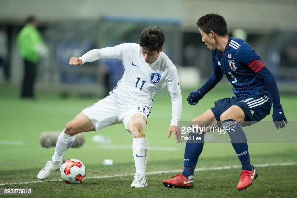 Gen of Japan and Lee Keunho of South Korea in action during the EAFF E1 Men's Football Championship between Japan and South Korea at Ajinomoto...