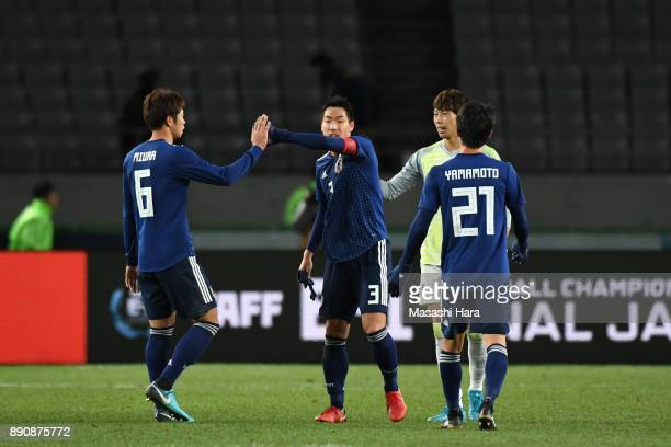 Gen Shoji and Japanese players celebrate their 21 victory in the EAFF E1 Men's Football Championship between Japan and China at Ajinomoto Stadium on...