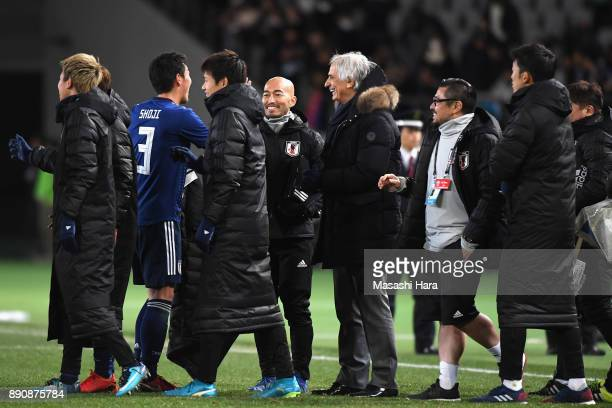 Gen Shoji is congratulated by head coach Vahid Halilhodzic after their 21 victory in the EAFF E1 Men's Football Championship between Japan and China...