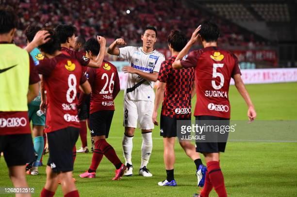 Gen SHOJI of Gamba Osaka and Kashima Antlers players elbow bump after the J.League Meiji Yasuda J1 match between Kashima Antlers and Gamba Osaka at...
