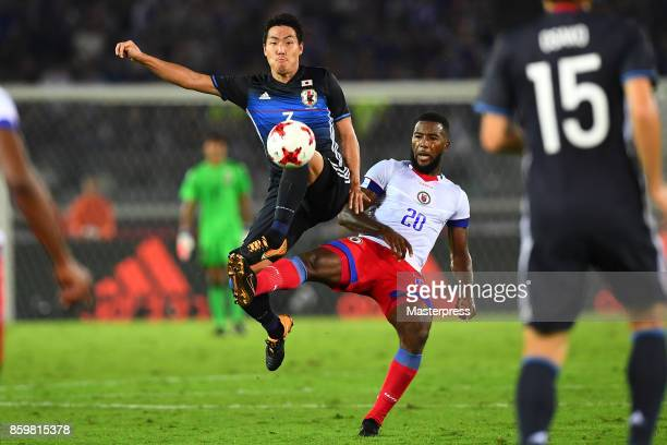 Gen Shoji of Japan and Duckens Nazon of Haiti compete for the ball during the international friendly match between Japan and Haiti at Nissan Stadium...