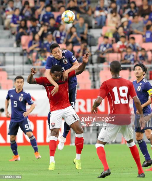 Gen Shoji of Japan and Levi Garcia of Trinidad Tobago compete for the ball during the international friendly match between Japan and Trinidad Tobago...