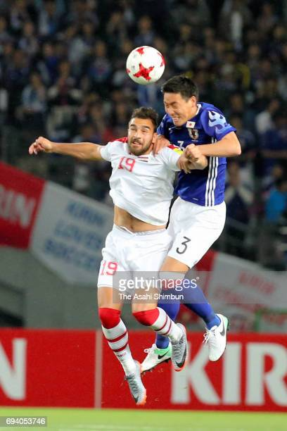 Gen Shoji of Japan and Mardik Mardikian of Syria compete for the ball during the international friendly match between Japan and Syria at Tokyo...