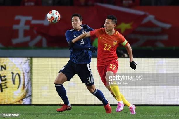 Gen Shoji of Japan and Yu Dabao of China compete for the ball during the EAFF E1 Men's Football Championship between Japan and China at Ajinomoto...