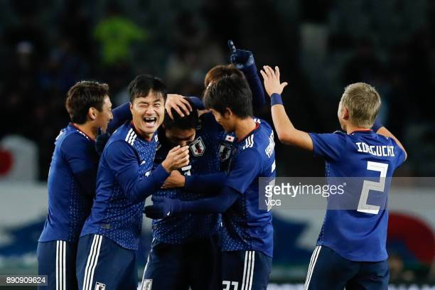 Gen Shoji of Japan celebrates a point with teammates during the EAFF E1 Men's Football Championship between Japan and China at Ajinomoto Stadium on...