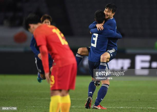 Gen Shoji of Japan celebrates scoring his side's second goal with his team mate Yasuyuki Konno during the EAFF E1 Men's Football Championship between...
