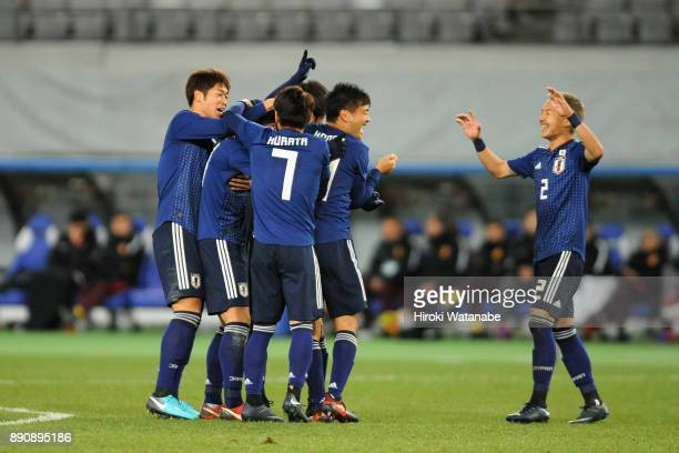 Gen Shoji of Japan celebrates scoring his side's second goal with his team mates during the EAFF E1 Men's Football Championship between Japan and...