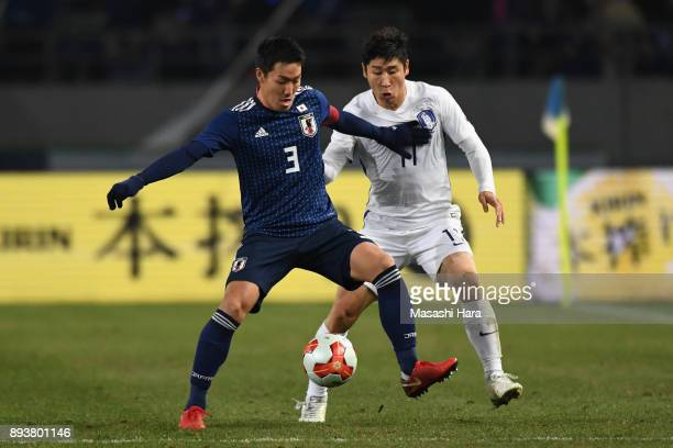 Gen Shoji of Japan controls the ball under pressure of Lee Keunho of South Korea during the EAFF E1 Men's Football Championship between Japan and...