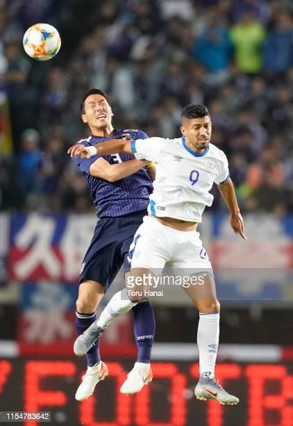 Gen Shoji of Japan in action against Nelson Bonilla of El Salvador during the international friendly match between Japan and El Salvador at...