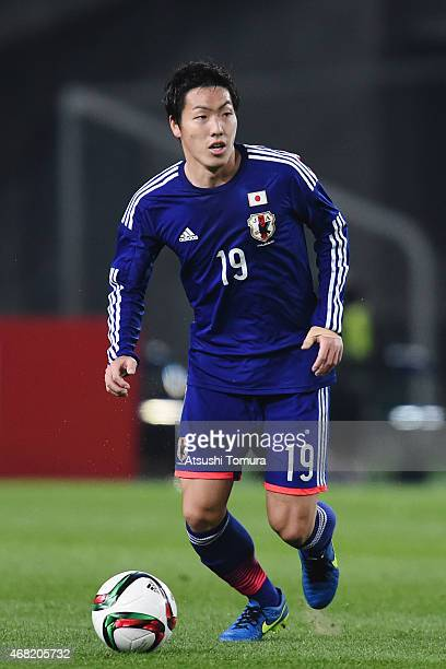 Gen Shoji of Japan runs with the ball during the international friendly match between Japan and Uzbekistan at Ajinomoto Stadium on March 31 2015 in...