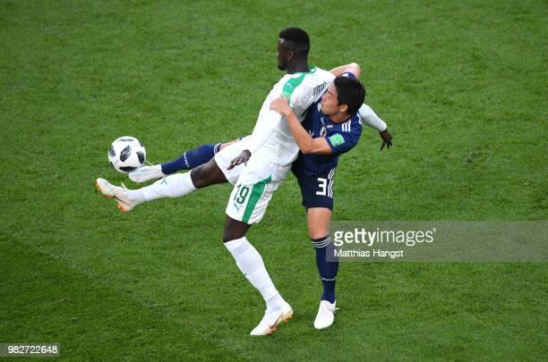 Gen Shoji of Japan tackles Mbaye Niang of Senegal during the 2018 FIFA World Cup Russia group H match between Japan and Senegal at Ekaterinburg Arena...