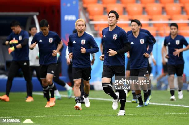 Gen Shoji of Japan warms up during a Japan training session ahead of the FIFA World Cup Group H match between Japan and Senegal at Ekaterinburg Arena...