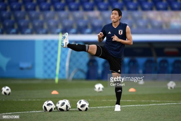 Gen Shoji of Japan warms up during a Japan training session ahead of the FIFA World Cup Group H match between Poland and Japan at Volgograd Arena on...