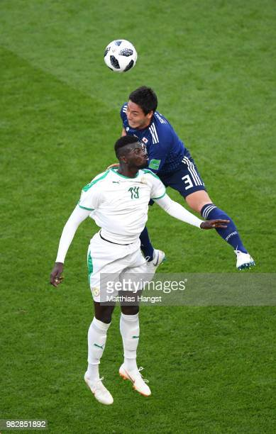 Gen Shoji of Japan wins a header over Mbaye Niang of Senegal during the 2018 FIFA World Cup Russia group H match between Japan and Senegal at...