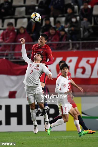 Gen Shoji of Kashima Antlers and Elkeson of Shanghai SIPG compete for the ball during the AFC Champions League Round of 16 first leg match between...