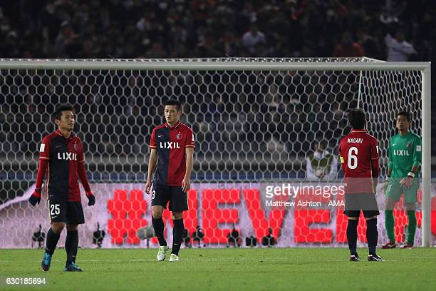 Gen Shoji of Kashima Antlers and his teammates look dejected after Cristiano Ronaldo of Real Madrid scored his team's third goal to make the score 32...