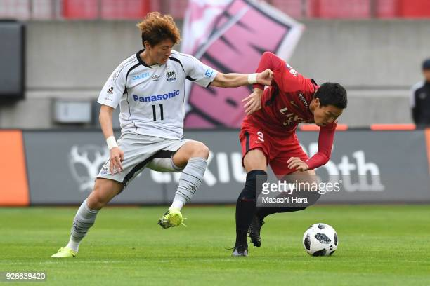 Gen Shoji of Kashima Antlers and Hwang Ui Jo of Gamba Osaka compete for the ball during the JLeague J1 match between Kashima Antlers and Gamba Osaka...