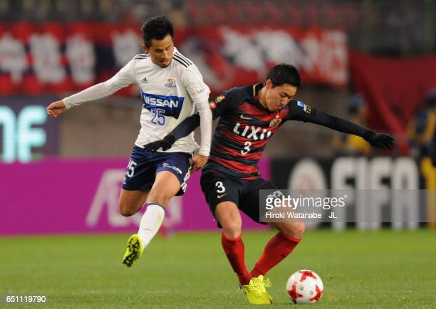 Gen Shoji of Kashima Antlers and Naoki Maeda of Yokohama FMarinos compete for the ball during the JLeague J1 match between Kashima Antlers and...