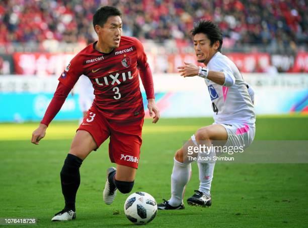 Gen Shoji of Kashima Antlers and Yoshiki Takahashi of Sagan Tosu compete for the ball during the JLeague J1 match between Kashima Antlers and Sagan...