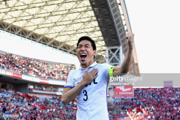 Gen Shoji of Kashima Antlers celebrates after his side's 1-0 victory in the J.League J1 match between Urawa Red Diamonds and Kashima Antlers at...