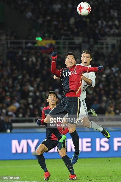 Gen shoji of Kashima Antlers competes for the ball against Cristiano Ronaldo of Real Madrid during the FIFA Club World Cup final match between Real...